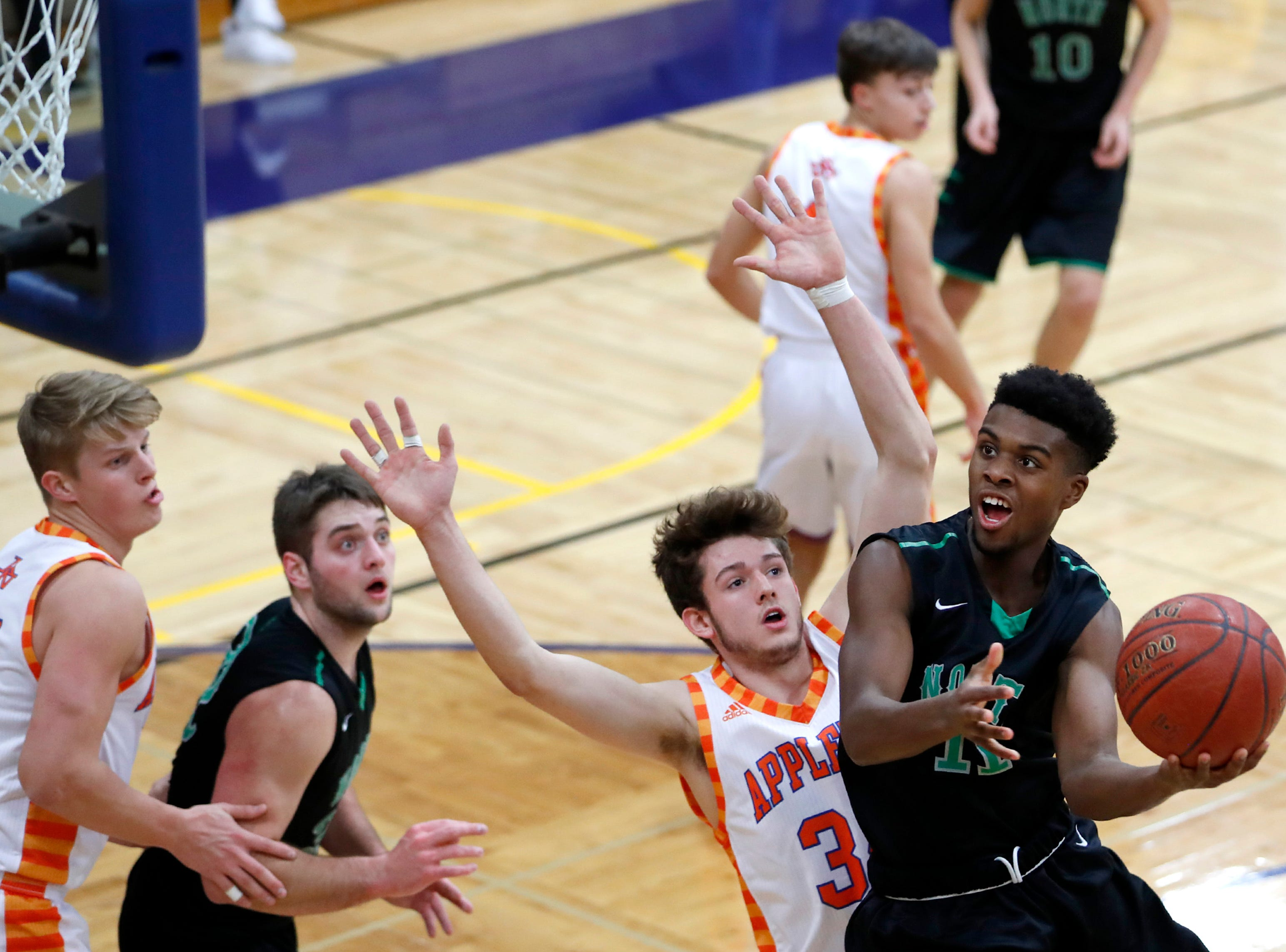 Oshkosh North High SchoolÕs Abraham Schiek jumps toward the basket for a layup during their game against Appleton West High School Tuesday, Jan. 15, 2019, at Appleton West High School in Appleton, Wis. Appleton West High School defeated Oshkosh North High School 72-63.