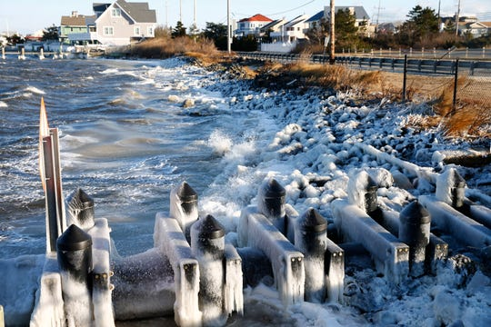 Wind whipped ice covers the Barnegat Bay shoreline along Route 35 southbound in Brick Township Monday, January 21, 2019.