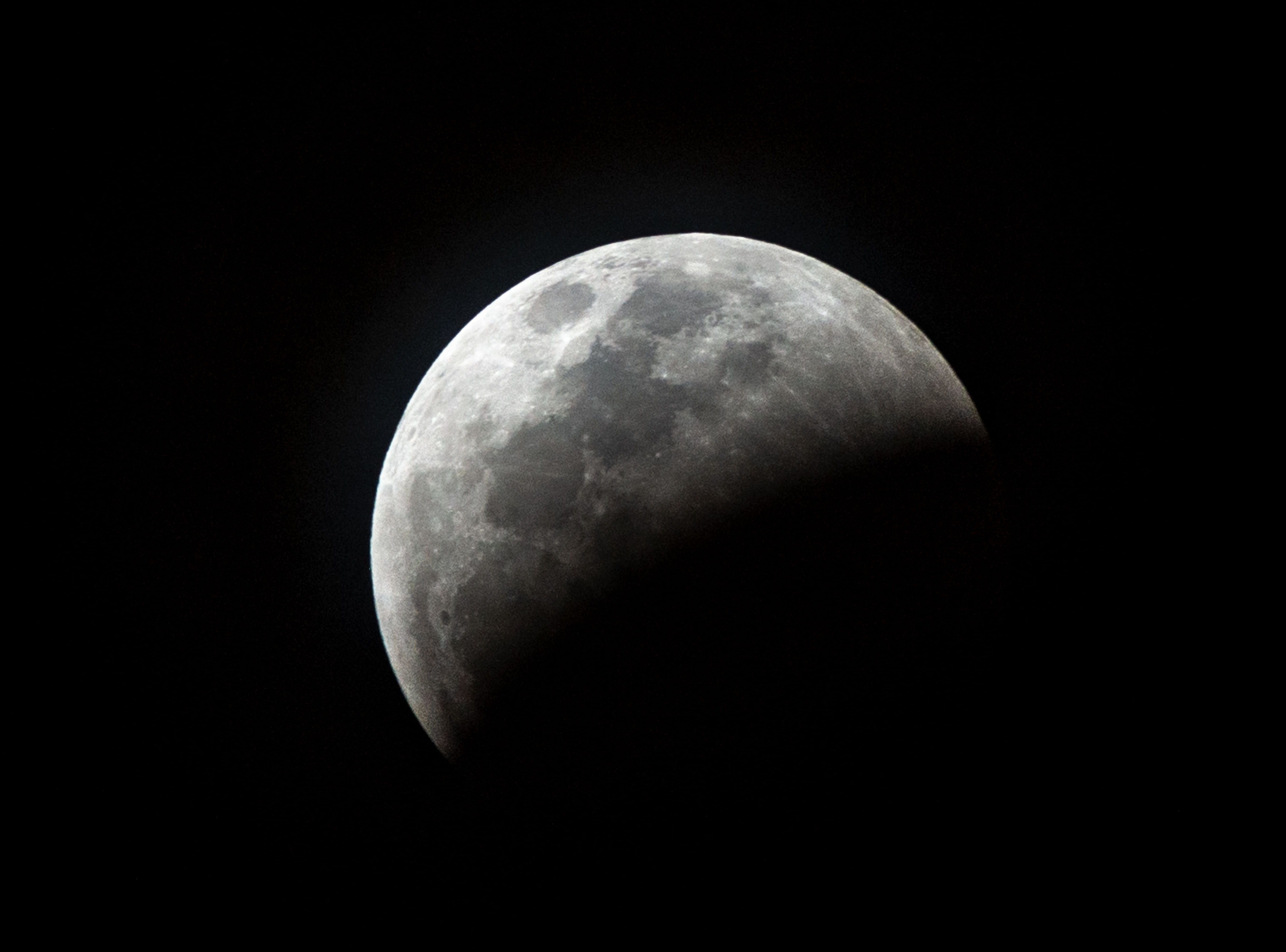 The so-called Super Blood Wolf Moon rises as a total lunar eclipse enters a partial phase where almost half of the Moon is immersed in Earth's unbra, on Sunday January 20, 2019, in Miami, Florida. - The January 21 total lunar eclipse will be the last one until May 2021, and the last one visible from the United States until 2022. (Photo by Gaston De Cardenas / AFP)GASTON DE CARDENAS/AFP/Getty Images