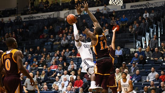 Monmouth's Ray Salnave hits the game-winning shot with 1.1 seconds remaining against Iona on Sunday.