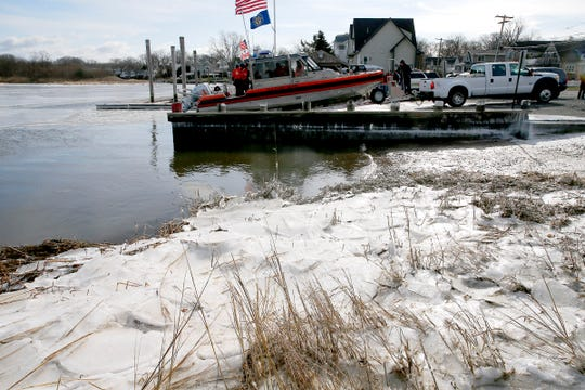 A US Coast Guard boat whose crew had rescued a stranded duck hunter in the Navesink River is pulled out of the water in Rumson Monday morning, January 21, 2019.