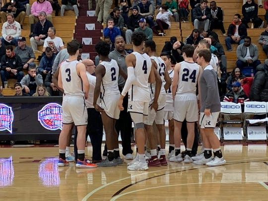 Ranney huddles up before playing Federal Way Monday morning at the Hoophall Classic