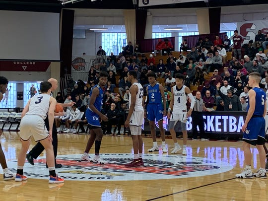 Ranney's Scottie Lewis (23) prepares to take the opening tip against Federal Way on Monday morning at the Hoophall Classic