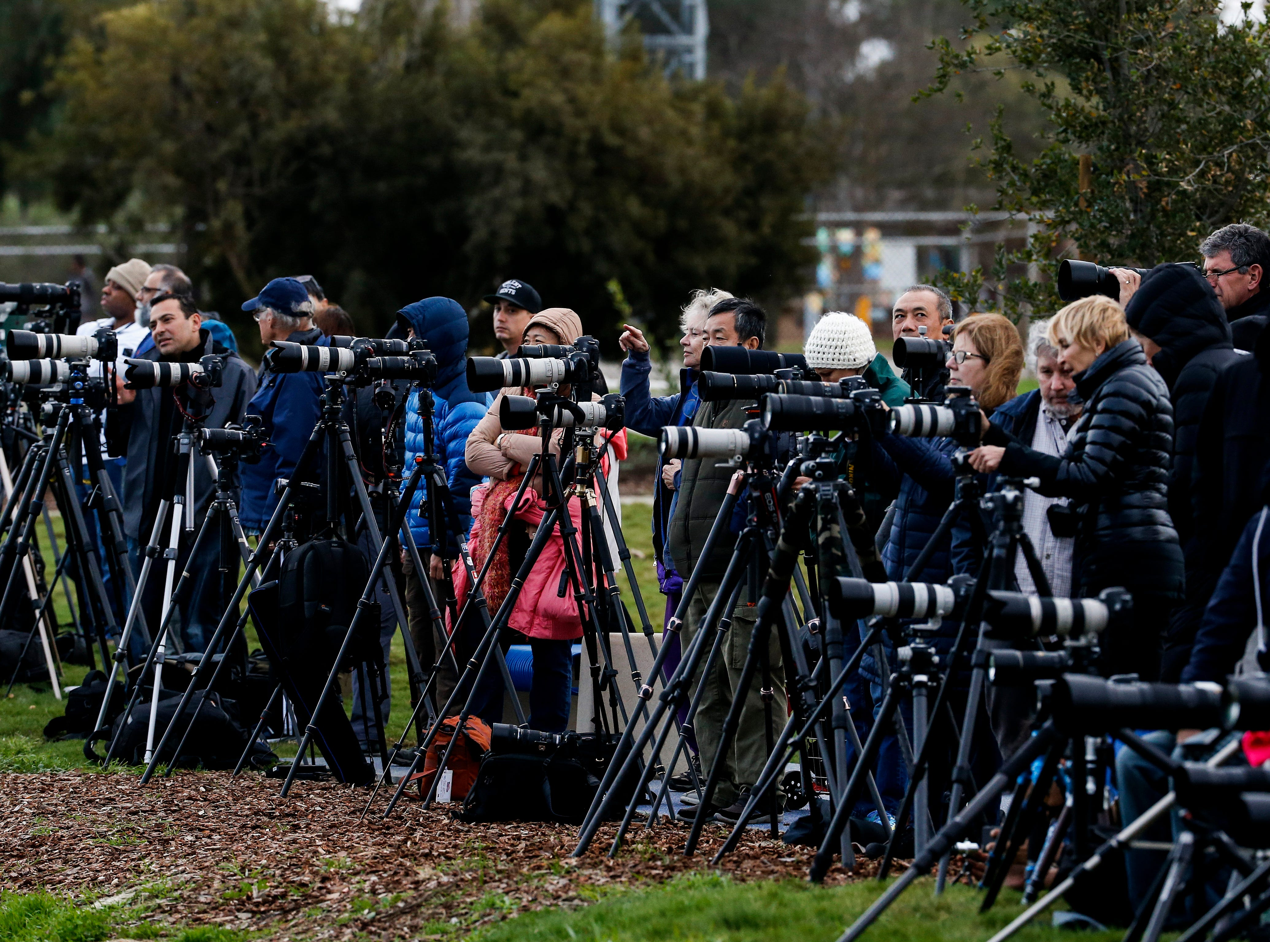 Photographers stage at Kenneth Hahn Park in Los Angeles as they wait to capture the supermoon, Sunday, Jan. 20, 2019. The year's first supermoon, when a full moon appears a little bigger and brighter thanks to its slightly closer position to Earth, is one of two lunar events Sunday. If skies are clear, a total eclipse will also be visible in North and South America, and parts of Europe. (AP Photo/Ringo H.W. Chiu)