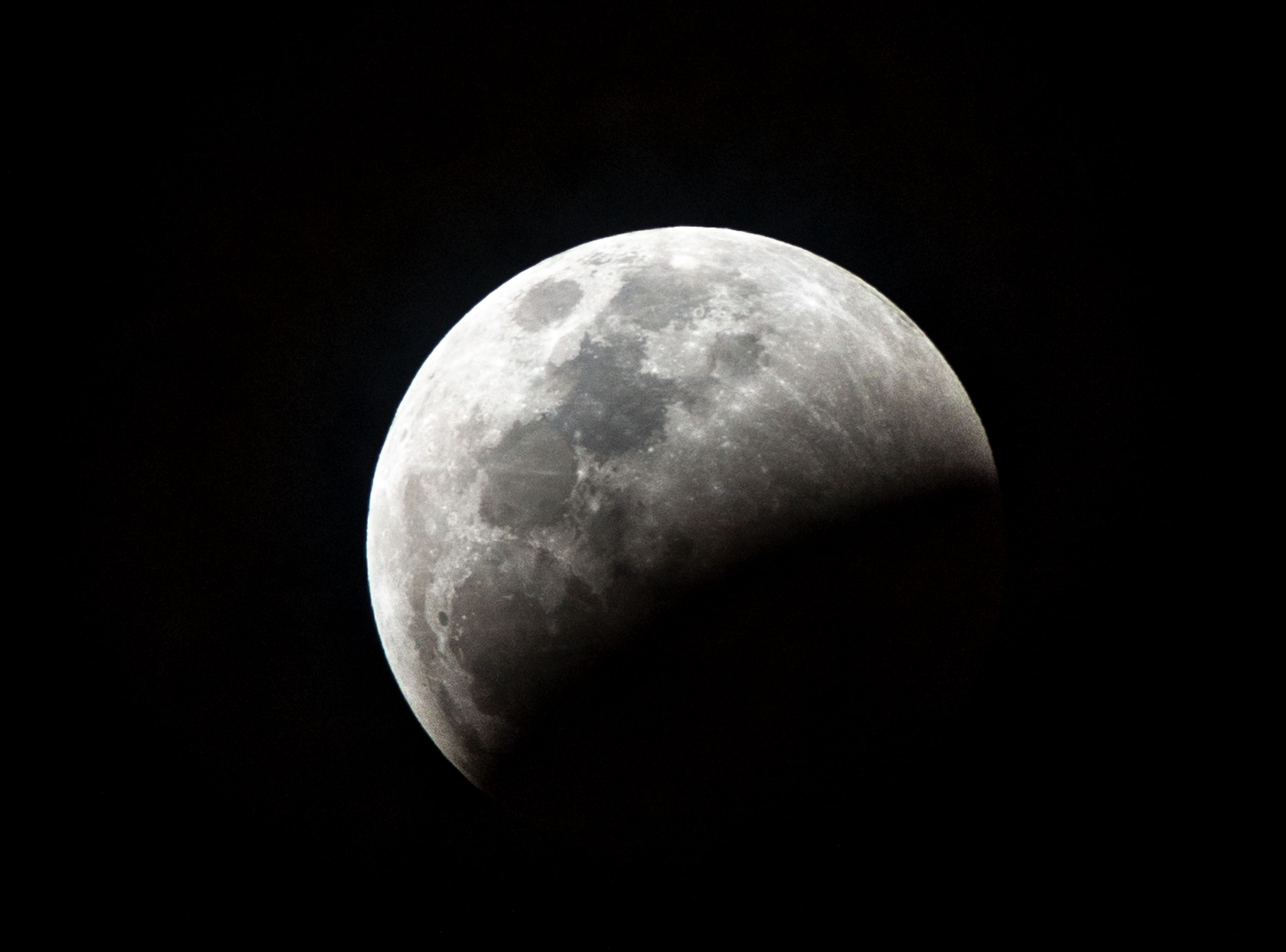 The so-called Super Blood Wolf Moon rises as a total lunar eclipse begins on Sunday January 20, 2019, in Miami, Florida. - The January 21 total lunar eclipse will be the last one until May 2021, and the last one visible from the United States until 2022. (Photo by Gaston De Cardenas / AFP)GASTON DE CARDENAS/AFP/Getty Images
