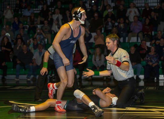 Howell's Neiko Malone smiles after he defeated South Plainfield's Thomas Fierro 4-2 in overtime for a key win in the Rebels' 30-28 win at South Plainfield on Jan. 17