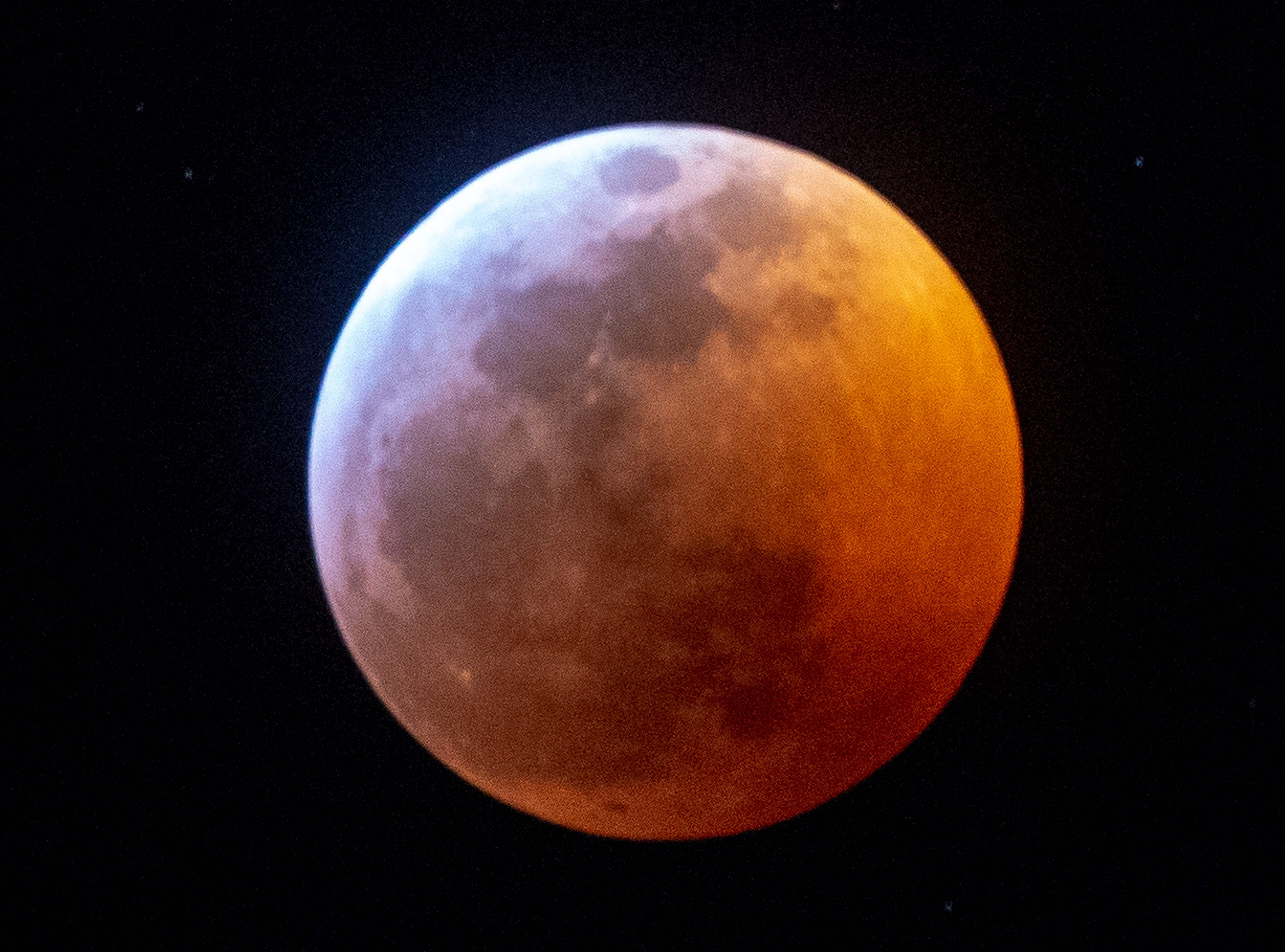 Earth's shadow almost totally obscures the view of the so-called Super Blood Wolf Moon during a total lunar eclipse, on Sunday January 20, 2019, in Miami, Florida. - The January 21 total lunar eclipse will be the last one until May 2021, and the last one visible from the United States until 2022. (Photo by Gaston De Cardenas / AFP)GASTON DE CARDENAS/AFP/Getty Images