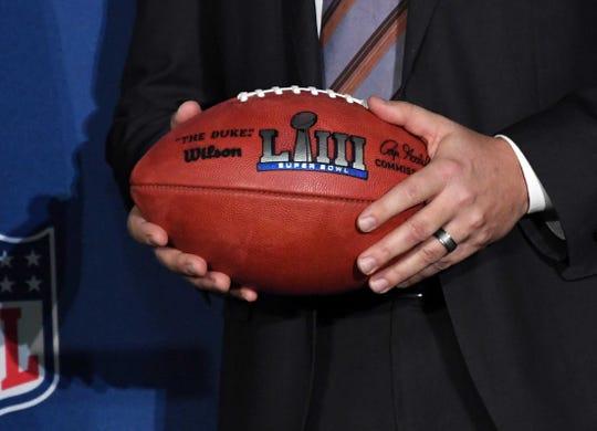 Atlanta Sports Council president Dan Corso holds a Super Bowl LIII logo football at handoff press conference at Mall of America.