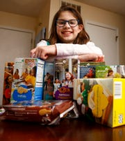 Girl Scout Lilia Dietz is shown with some of her cookies in her Holmdel home Monday, January 21, 2019.