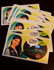Girl Scout Lilia Dietz is shown on business cards used to promote her cookie sales