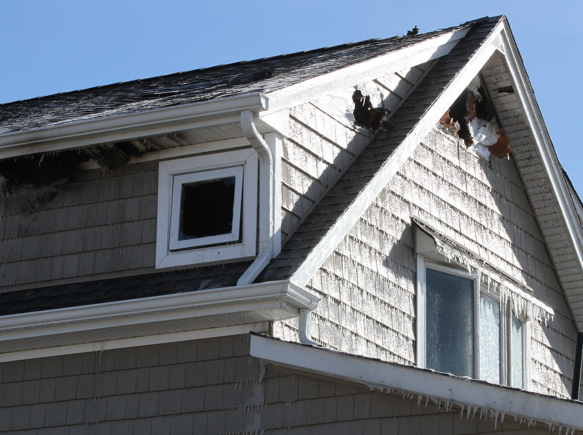 Ice covers the siding after a fire at a residence next to Point Lobster Company in the Point Pleasant Beach Monday afternoon, January 21, 2019.