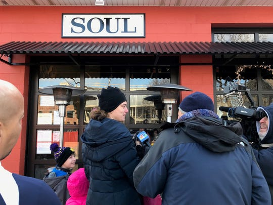 A family arrives the Soul Kitchen in Red Bank on Monday, Jan. 21 where the Murphy Family Foundation and the Bon Jovi Soul Foundation was sponsoring free lunches for furloughed federal workers.