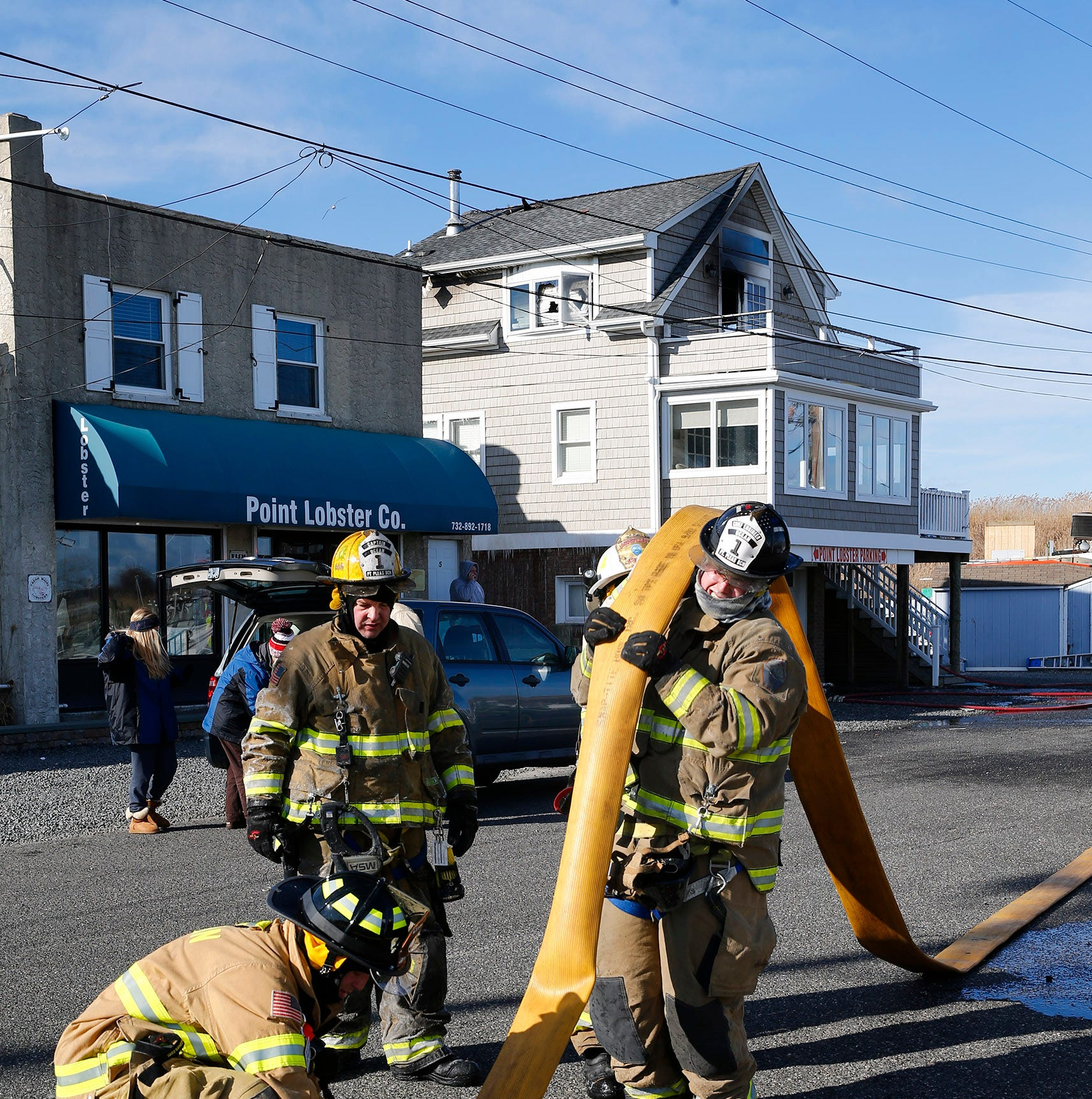 Point Pleasant Beach firefighters empty hoses...