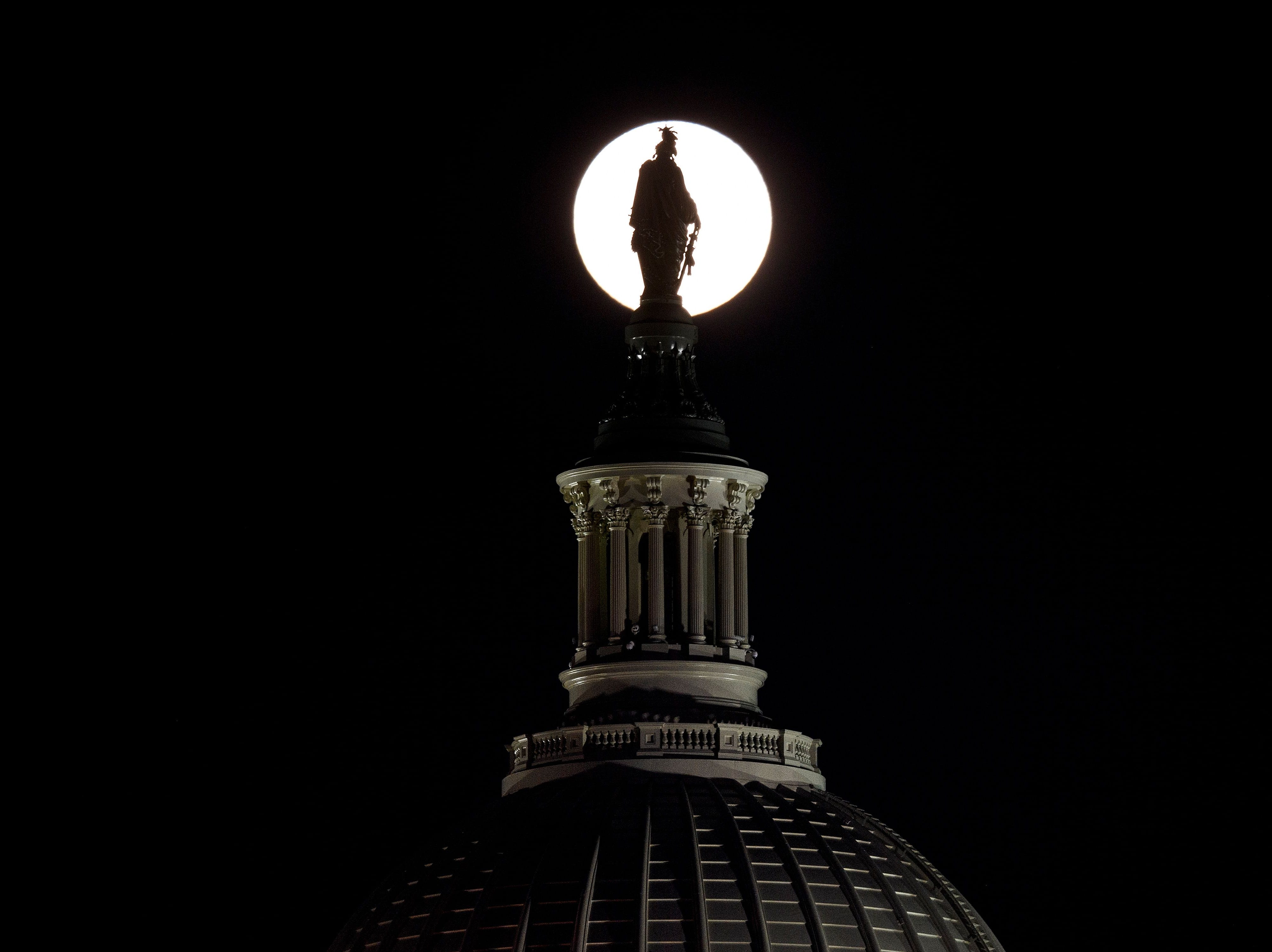 The Statue of Freedom on top of the US Capitol dome is seen silhouetted against the super moon on January 20, 2019 in Washington, DC. (Photo by Brendan Smialowski / AFP)BRENDAN SMIALOWSKI/AFP/Getty Images
