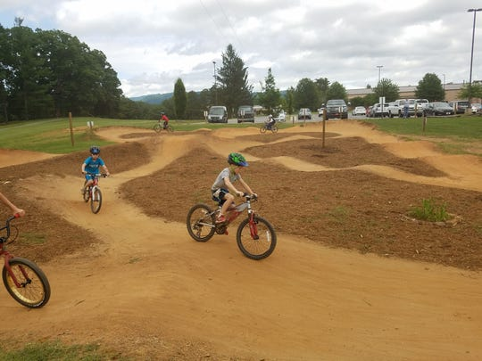 Kolo Bike Park at the Adventure Center of Asheville, west of downtown, offers mountain biking camp for spring break and summer.