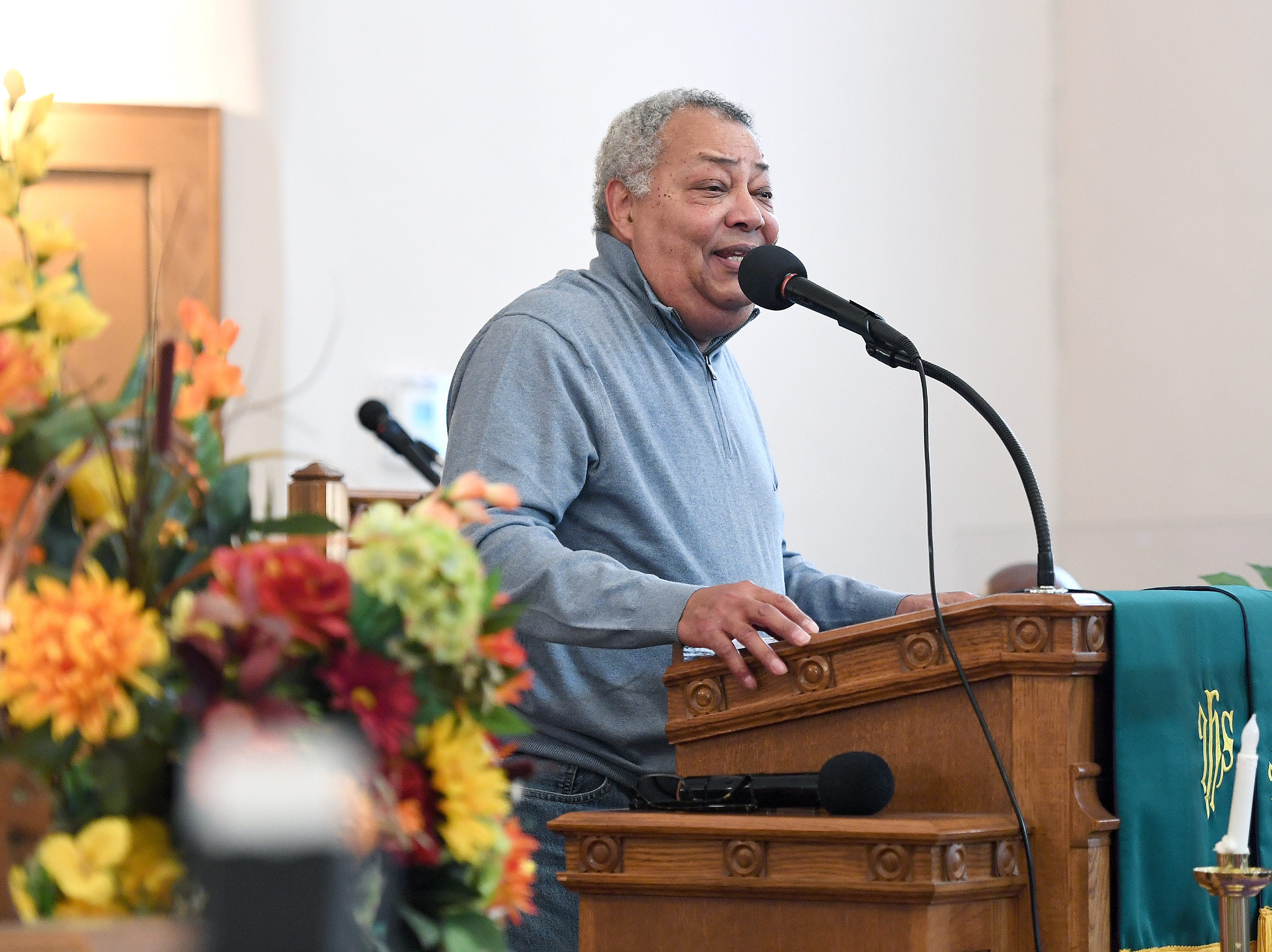 Buncombe County Commissioner Al Whitesides speaks to the crowd at St. James AME Church during the Dr. Martin Luther King, Jr. Peace March and Rally on Jan. 21, 2019.