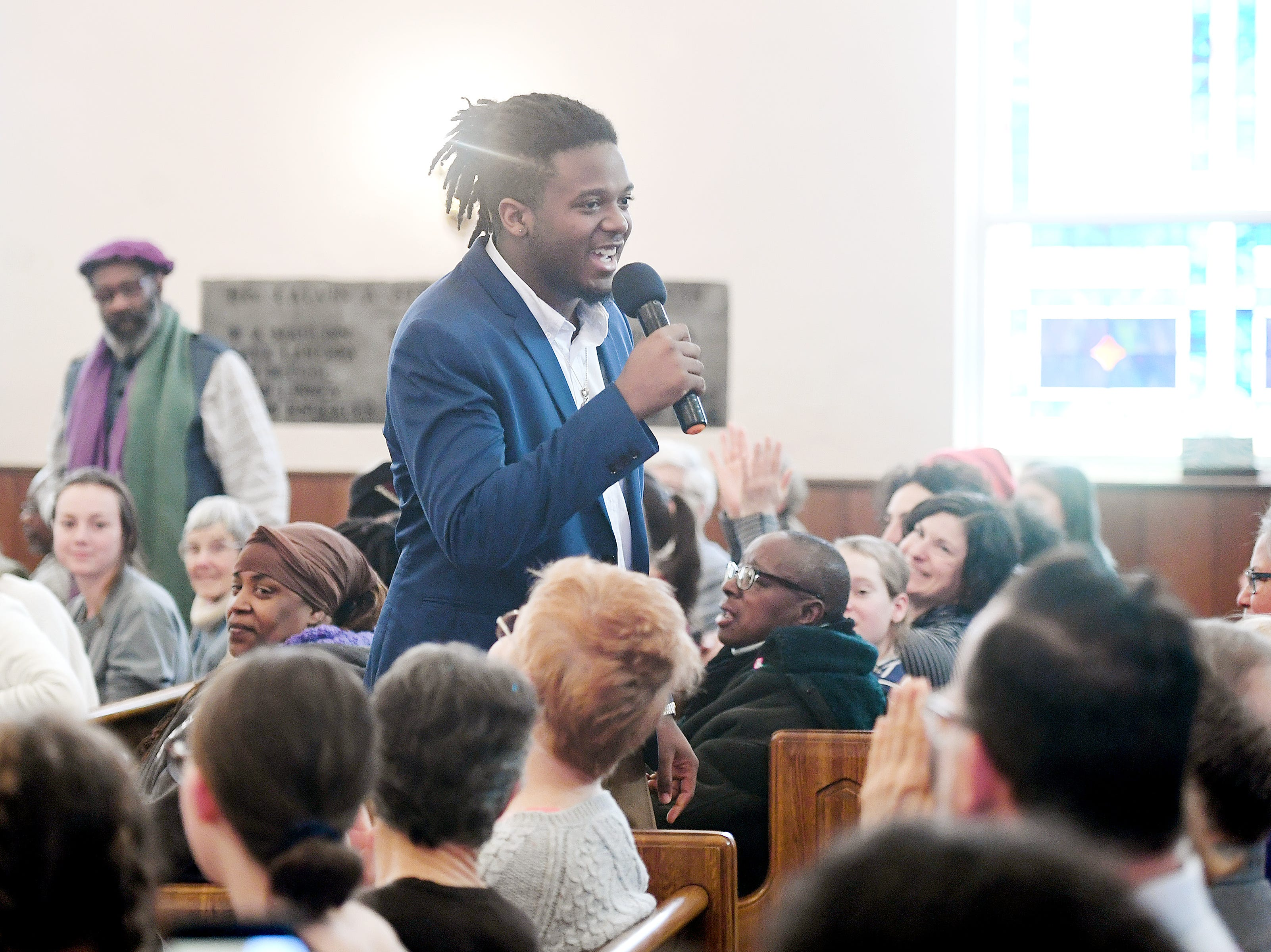 Zion Morgan, a student at Roberson High School, sings to the crowd at St. James AME Church during the Dr. Martin Luther King, Jr. Peace March and Rally on Jan. 21, 2019.
