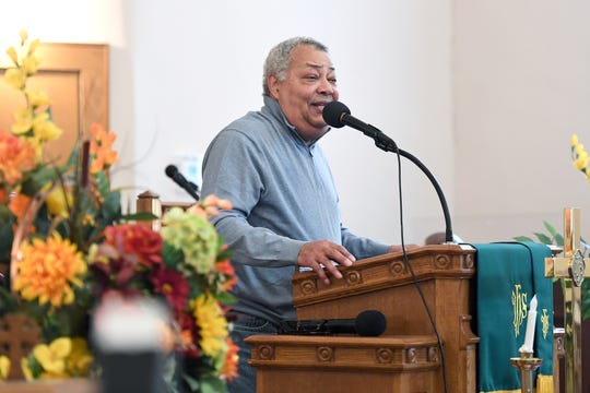 Buncombe County Commissioner Al Whitesides speaks to the crowd at St. James AME Church during the Dr. Martin Luther King, Jr. Peace March and Rally Monday.