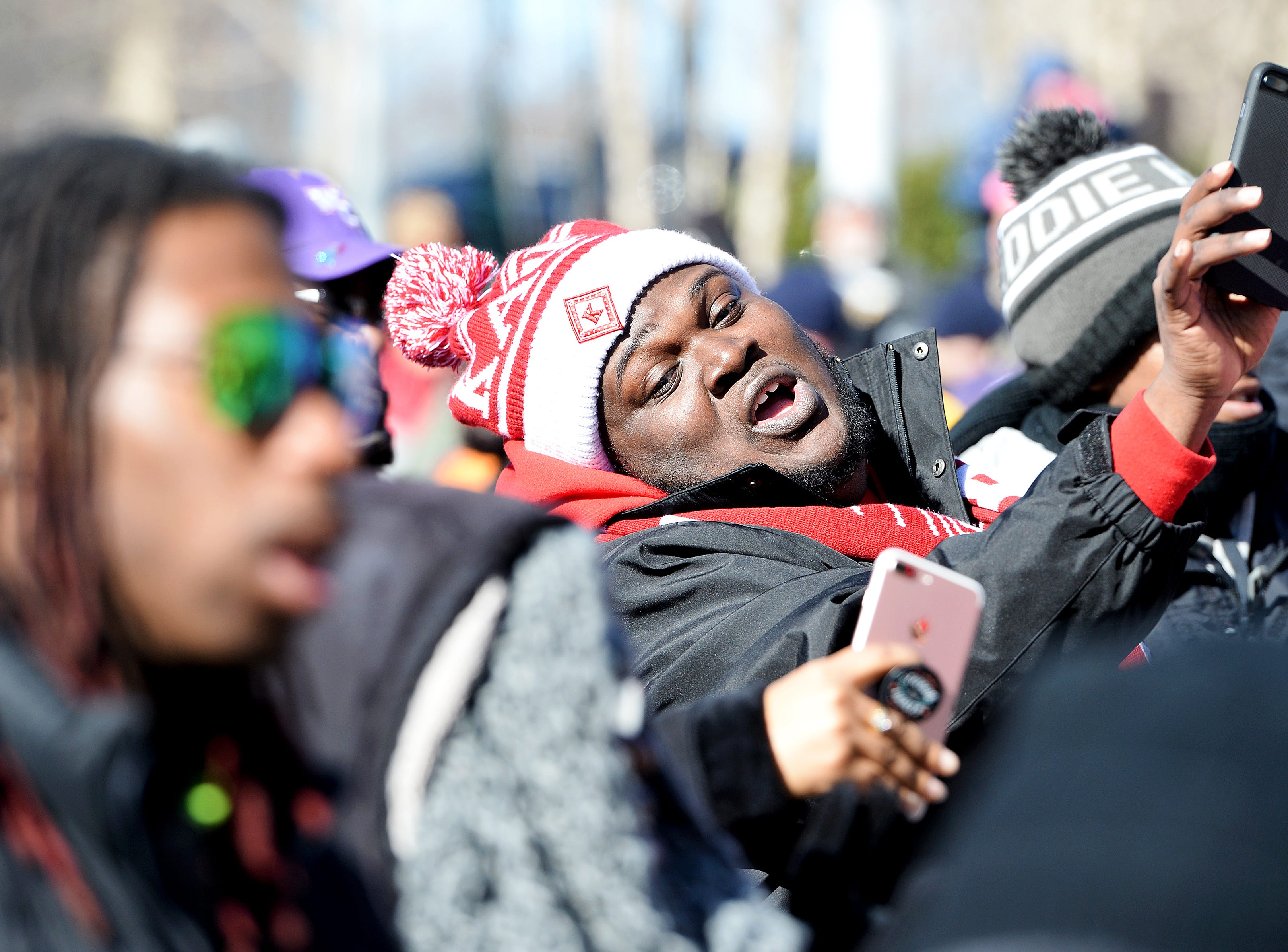 Stephen Blount takes a cell phone video as the crowd dances during the Dr. Martin Luther King, Jr. Peace March and Rally at Pack Square Park on Jan. 21, 2019.