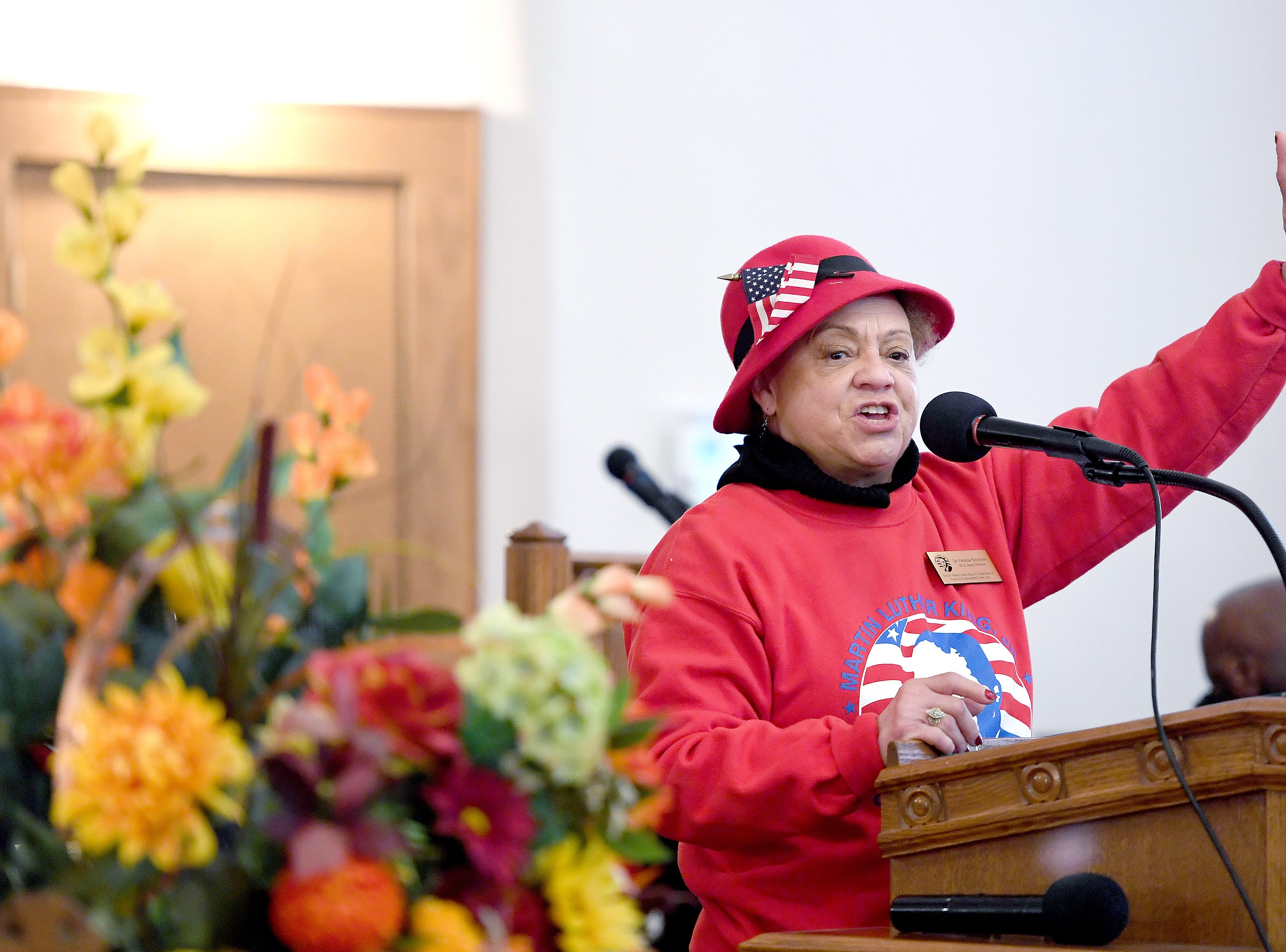 Dr. Oralene Simmons, MLK Association board president speaks to the crowd at St. James AME Church during the Dr. Martin Luther King, Jr. Peace March and Rally on Jan. 21, 2019.