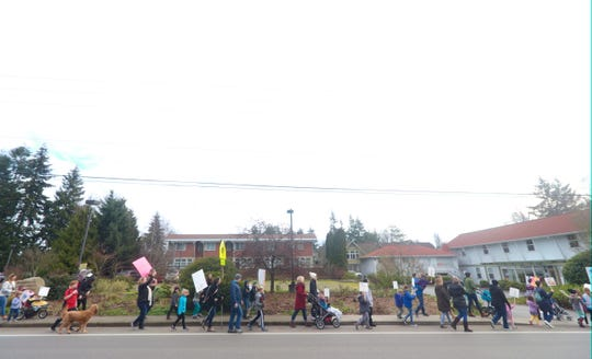 A Martin Luther King Jr. Day march heads down Madison Avenue on Bainbridge Island on Monday.