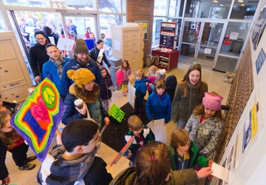 Youths mail letters they wrote to leaders at the post office in Winslow as part of an MLK Day event on Monday.