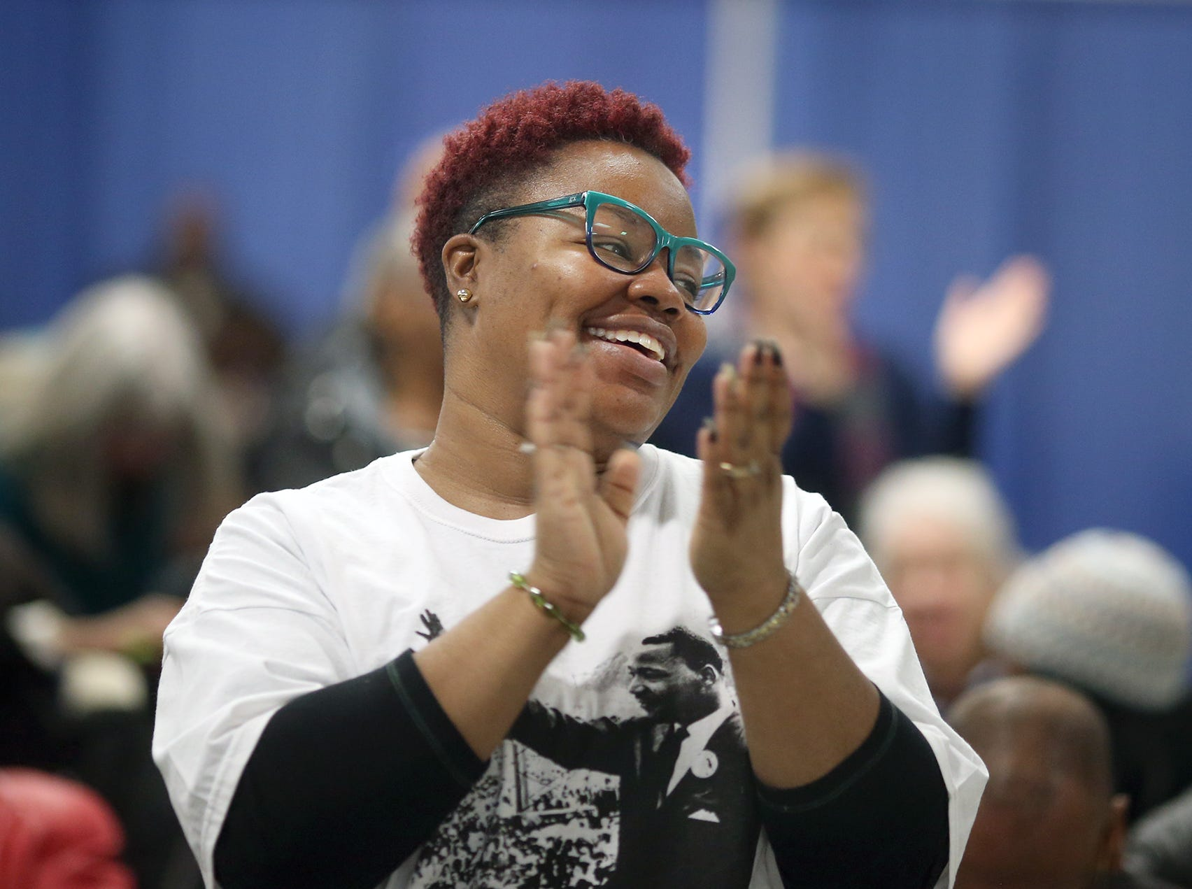 Candyce Chattman of Bremerton applauds the MLK Community Choir at the 25th annual Reverend Dr. Martin Luther King, Jr. celebration was held at PresidentsÕ Hall at the Kitsap County Fairgrounds on Monday, January, 21 , 2019.