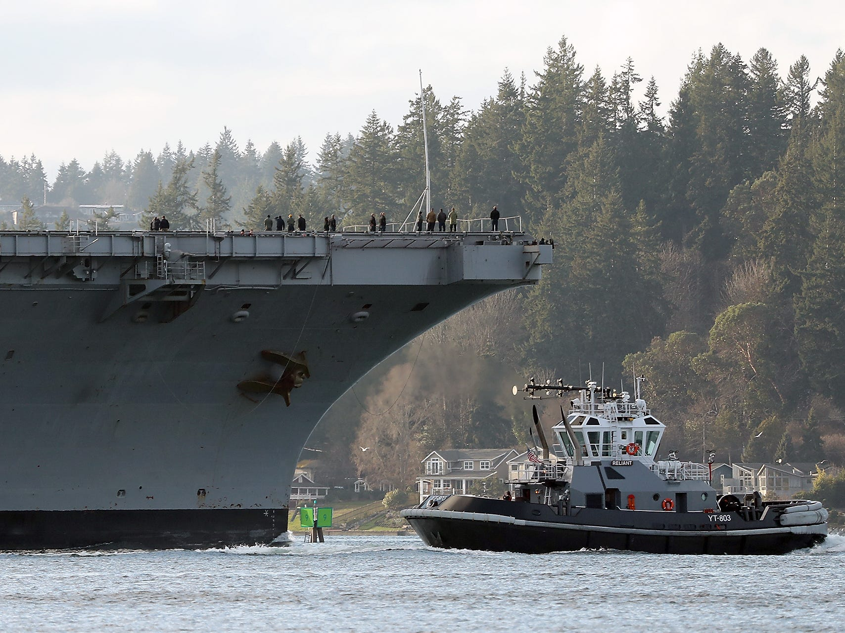 The USS Carl Vinson makes its way to Naval Base Kitsap-Bremerton as viewed from Bainbridge Island on Sunday, January 20, 2019.