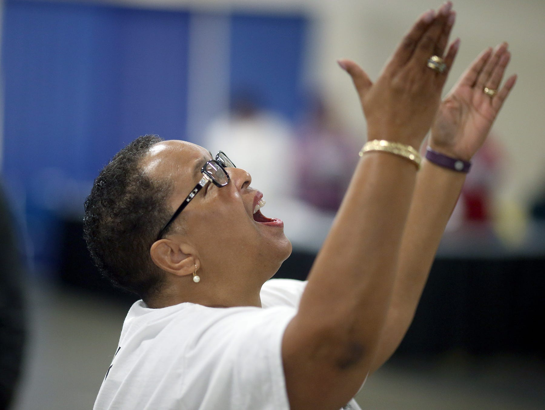 MLK Community Choir director Pam Farrior leads the choir at the 25th annual Reverend Dr. Martin Luther King, Jr. celebration was held at PresidentsÕ Hall at the Kitsap County Fairgrounds on Monday, January, 21 , 2019.