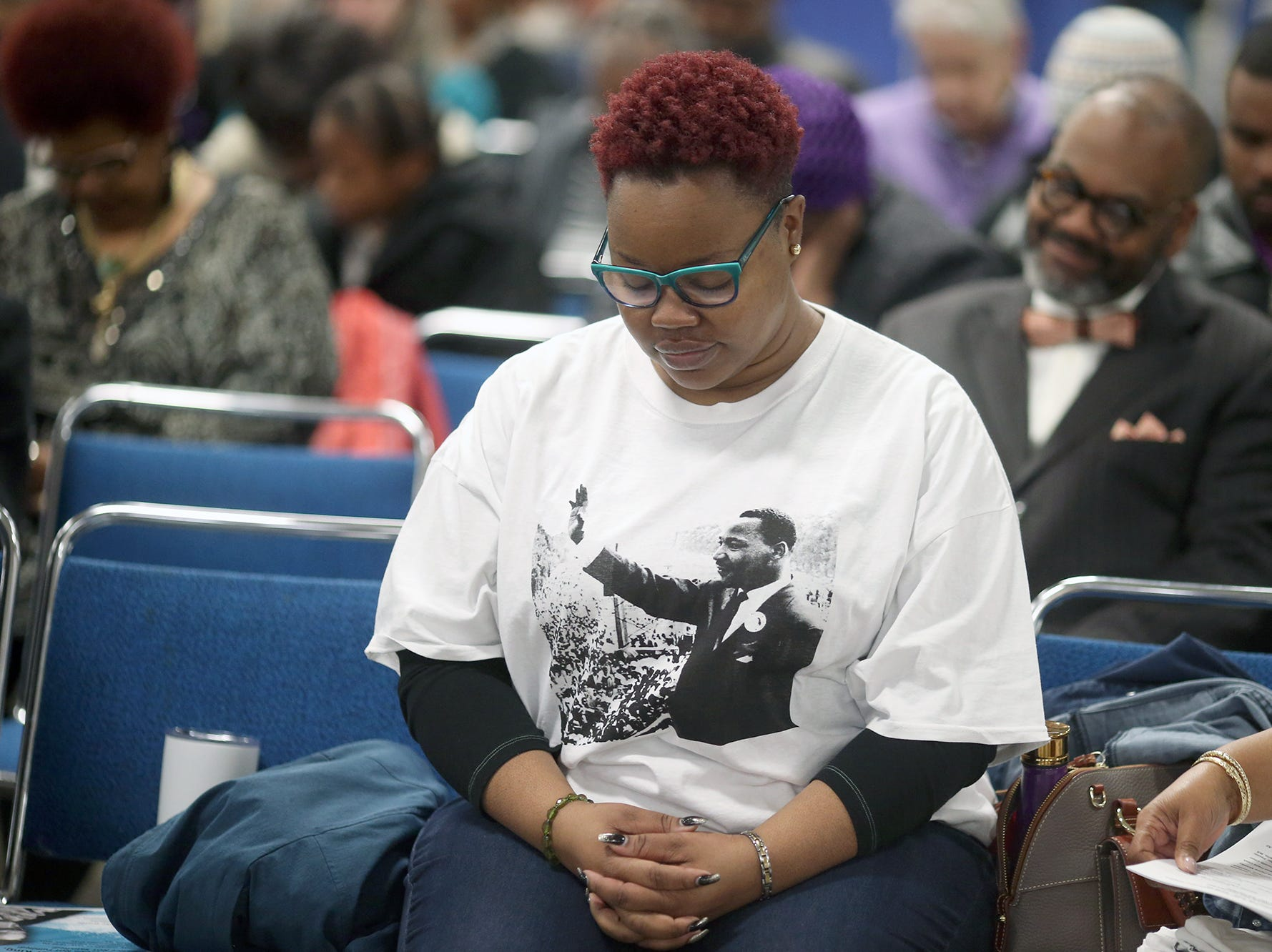Candyce Chattman of Bremerton bows for prayer  at the 25th annual Reverend Dr. Martin Luther King, Jr. celebration was held at PresidentsÕ Hall at the Kitsap County Fairgrounds on Monday, January, 21 , 2019.
