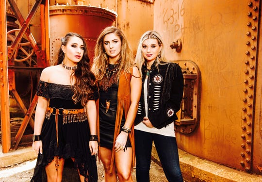 Savannah Coker (from left), Kate Falcon and Victoria Camp came from different parts of Alabama to form the Sweet Tea Trio.