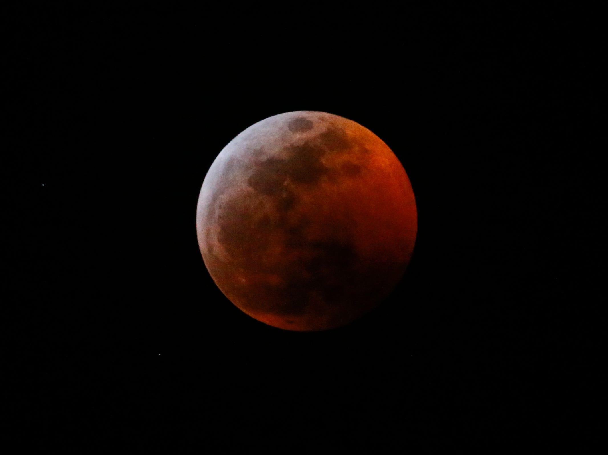 A lunar eclipse progresses is seen in Los Angeles, Sunday Jan. 20, 2019.