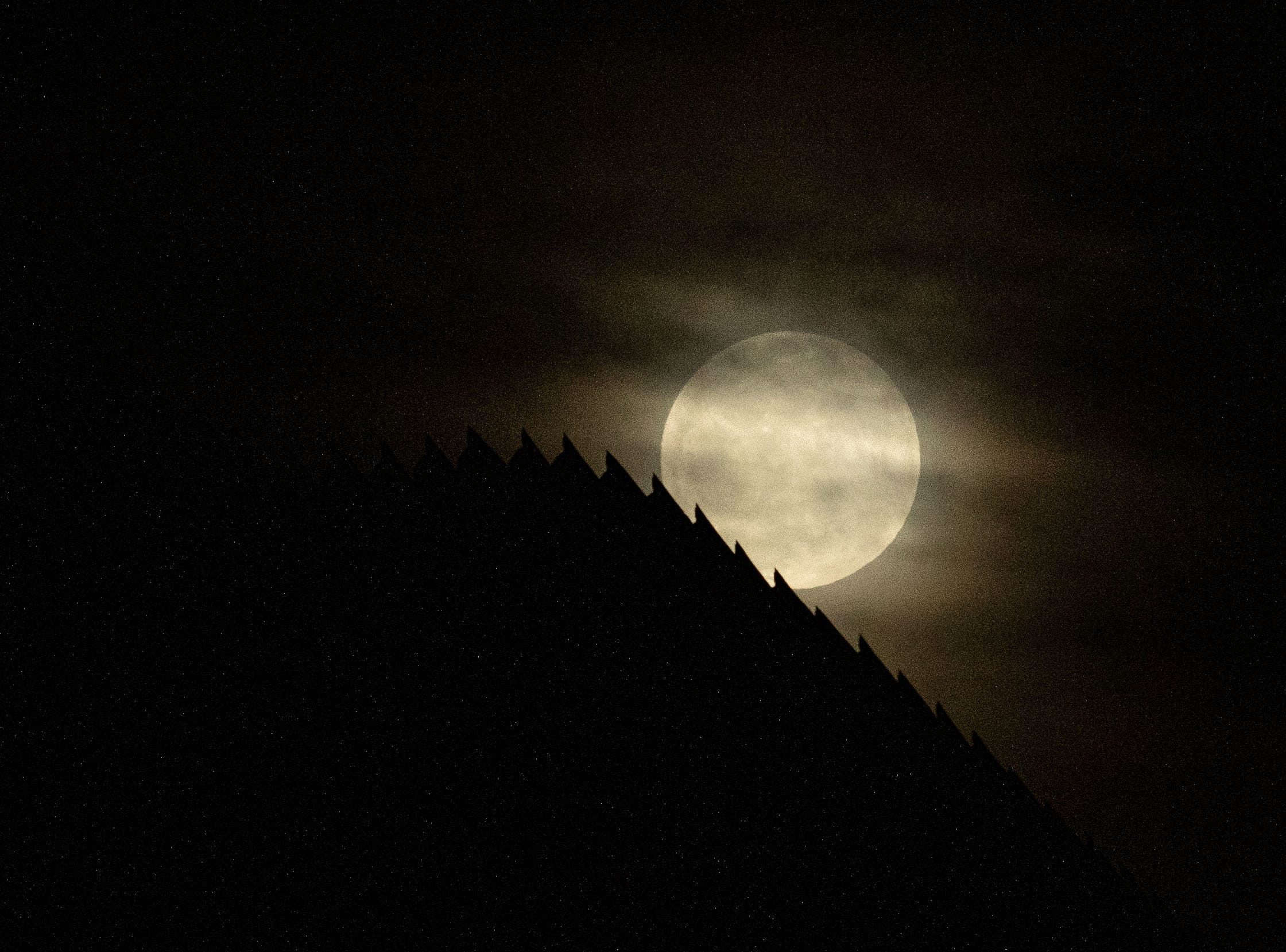 The US-Mexico border fence is silhouetted by the moon light in Tijuana, in Baja California state, Mexico, on January 20, 2019. (Photo by Guillermo Arias / AFP)        (Photo credit should read GUILLERMO ARIAS/AFP/Getty Images)
