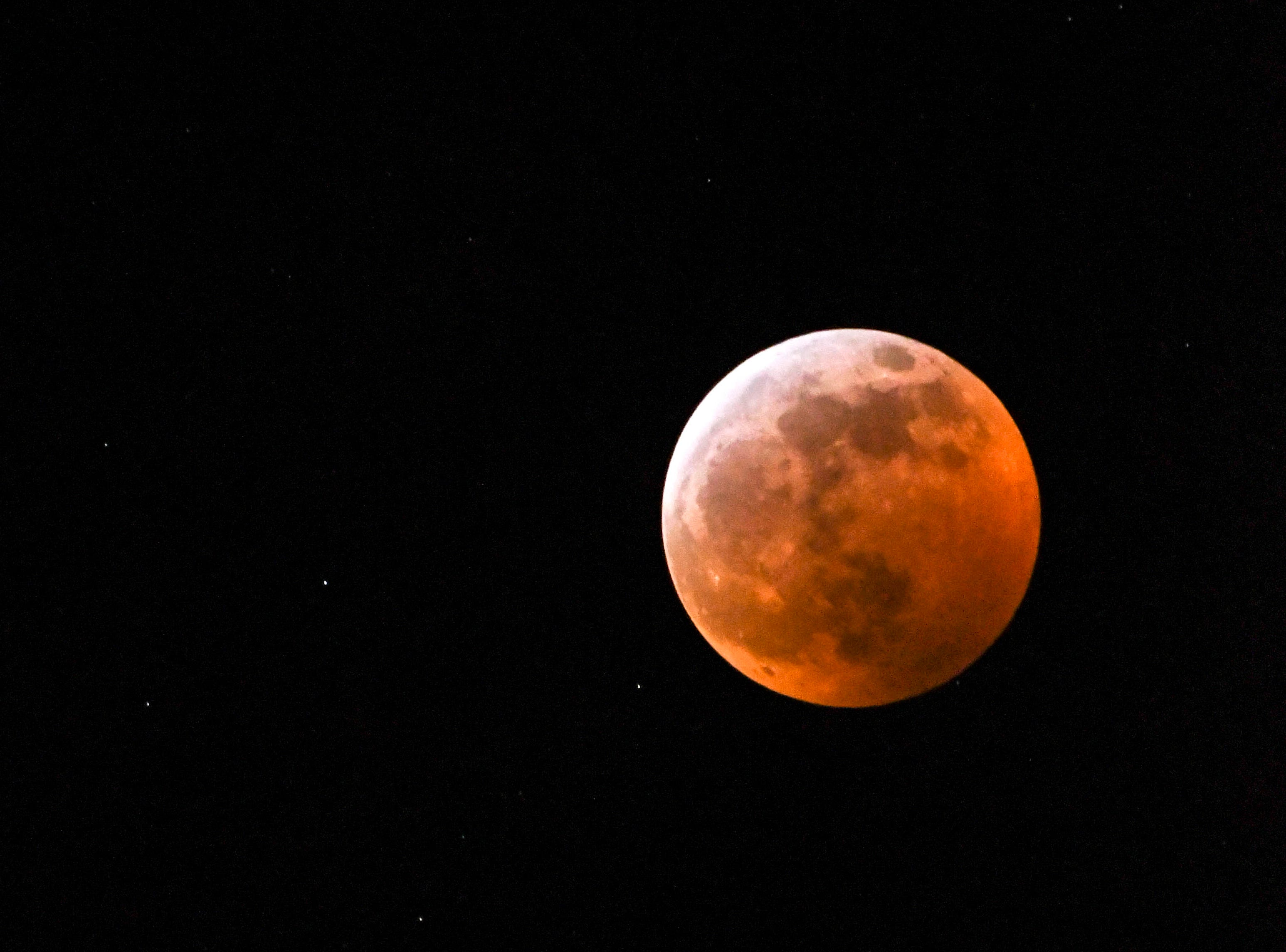 The Super Blood Wolf Moon (and a few stars) shine over Brevard County Sunday evening and Monday morning