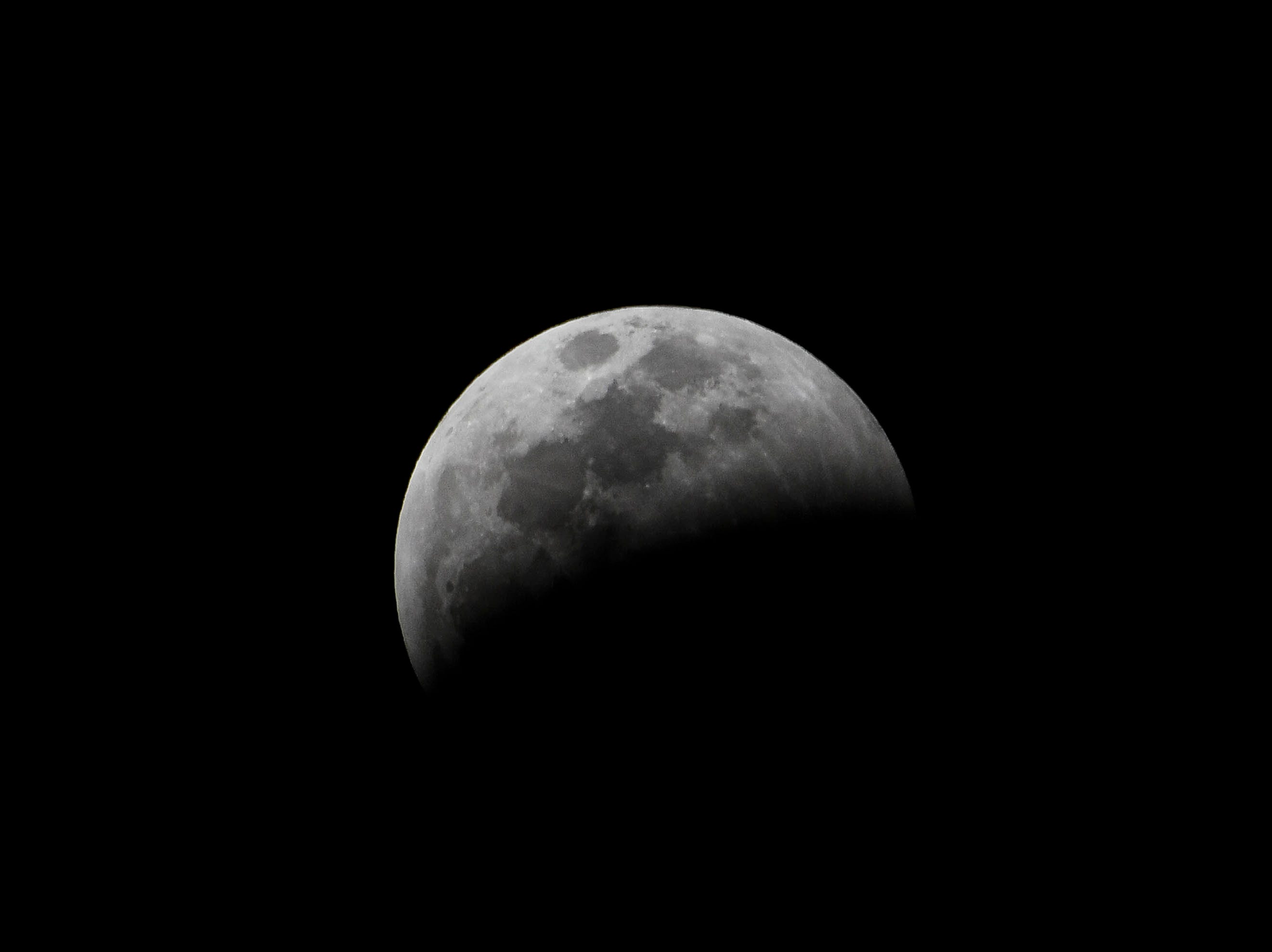 The Super Wolf Moon enters Earth's shadow over Brevard County Sunday evening.