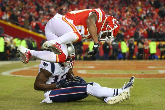 New England Patriots wide receiver Phillip Dorsett (13) scores a touchdown as Kansas City Chiefs cornerback Steven Nelson (20) defends during the first half of the AFC Championship game at Arrowhead Stadium.