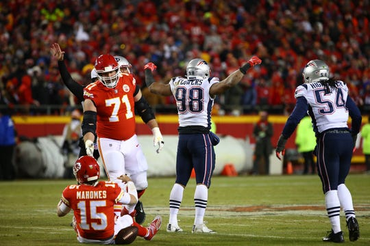 New England Patriots defensive end Trey Flowers (98) reacts after sacking Kansas City Chiefs quarterback Patrick Mahomes (15) during the first half of the AFC Championship game at Arrowhead Stadium.