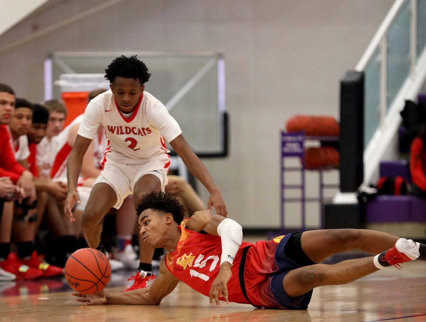 Purcell Marian guard Clark Jefferson battles Steve Gentry of Deer Park for a loose ball during their basketball game at the Midwest Classic, Sunday, Jan. 20, 2019.