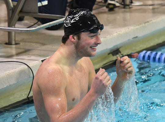 Adam Chaney of Mason smiles after winning the 100-yard freestyle at the Southwest Ohio Swimming Classic, St. Xavier High School, Sunday Jan. 20, 2019.