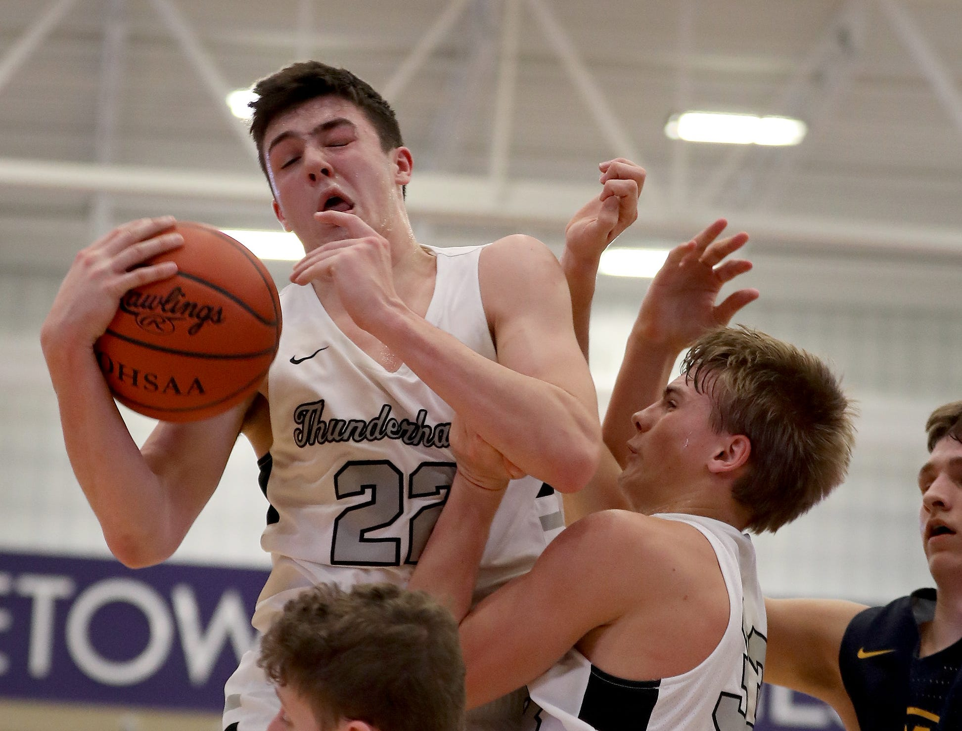 Lakota East guard Bash Wieland (22)  grabs a rebound during the Thunderhawks' basketball game against Moeller in the Midwest King Classic, Sunday, Jan. 20,2019.