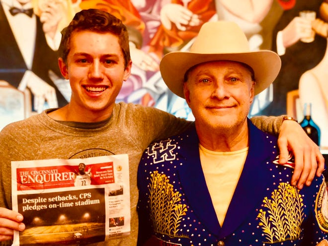 Michael Hodge and Jeff Ruby with the Jan. 19 edition of the Cincinnati Enquirer. Ruby tweeted the photo to show Hodge was in Cincinnati with him and not in Washington D.C.