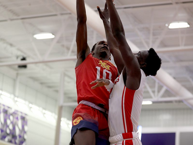 Purcell Marian guard Alex Dotson drives to the basket over Deer Park guard Ibrahima Athie during the Midwest King Classic Sunday, Jan. 20, 2019.