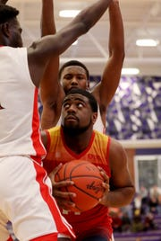 Purcell Marian forward Javonta Lyons drives to the basket during their basketball game against Deer Park in the Midwest King Classic Sunday, Jan. 20, 2019.