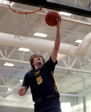 Moeller forward Alec Pfriem drives to the basket during the Crusaders' win over Lakota East in the Midwest King Classic, Sunday, Jan. 20,2019.