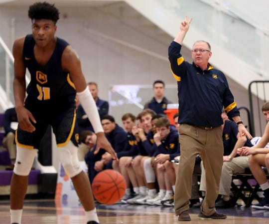 Moeller head coach Carl Kremer calls out a play while Miles McBride (11) dribbles the ball during the Crusaders' win over Lakota East, Sunday, Jan. 20, 2019.