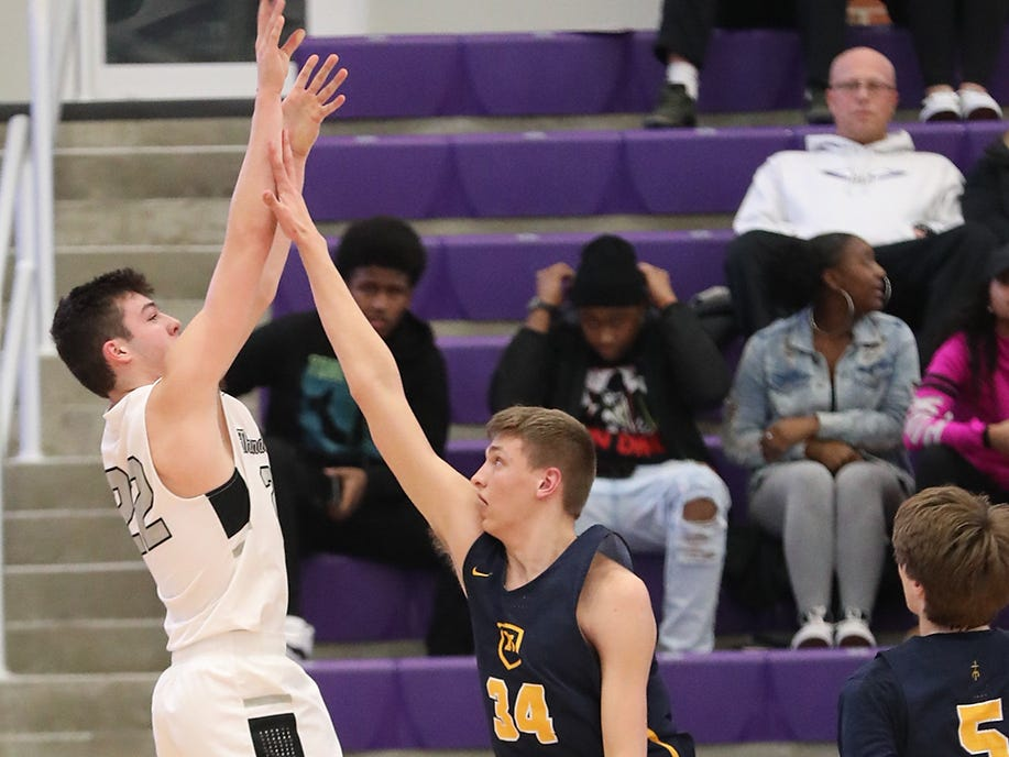 Lakota East guard Bash  Wieland (22) shoots over Moeller center Logan Duncomb during their game at the Midwest King Classic, Sunday, Jan. 20, 2019.