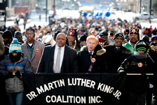 From right, Doir Betts, 14, State Senator Cecil Thomas, Rabbi Gary Zola, Jay Payne, MLK Coalition president, and Simeon Betts, 11, lead the 44th annual Martin Luther King Jr. Day Memorial March on Monday, Jan. 21, 2019 from the Freedom Center to Music Hall in Cincinnati.
