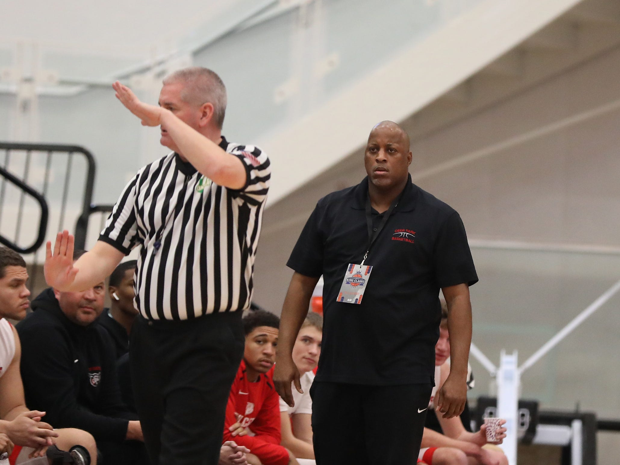 Deer Park head coach Steve Gentry gets teed up by an official during their basketball game against Purcell Marian Sunday, Jan. 20, 2019.