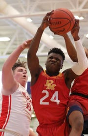 Bryan Warah (24) of Purcell Marian comes up with a rebound in the game against Deer Park Jan. 20 in the Midwest King Classic. Purcell Marian beat Deer Park 83-67.