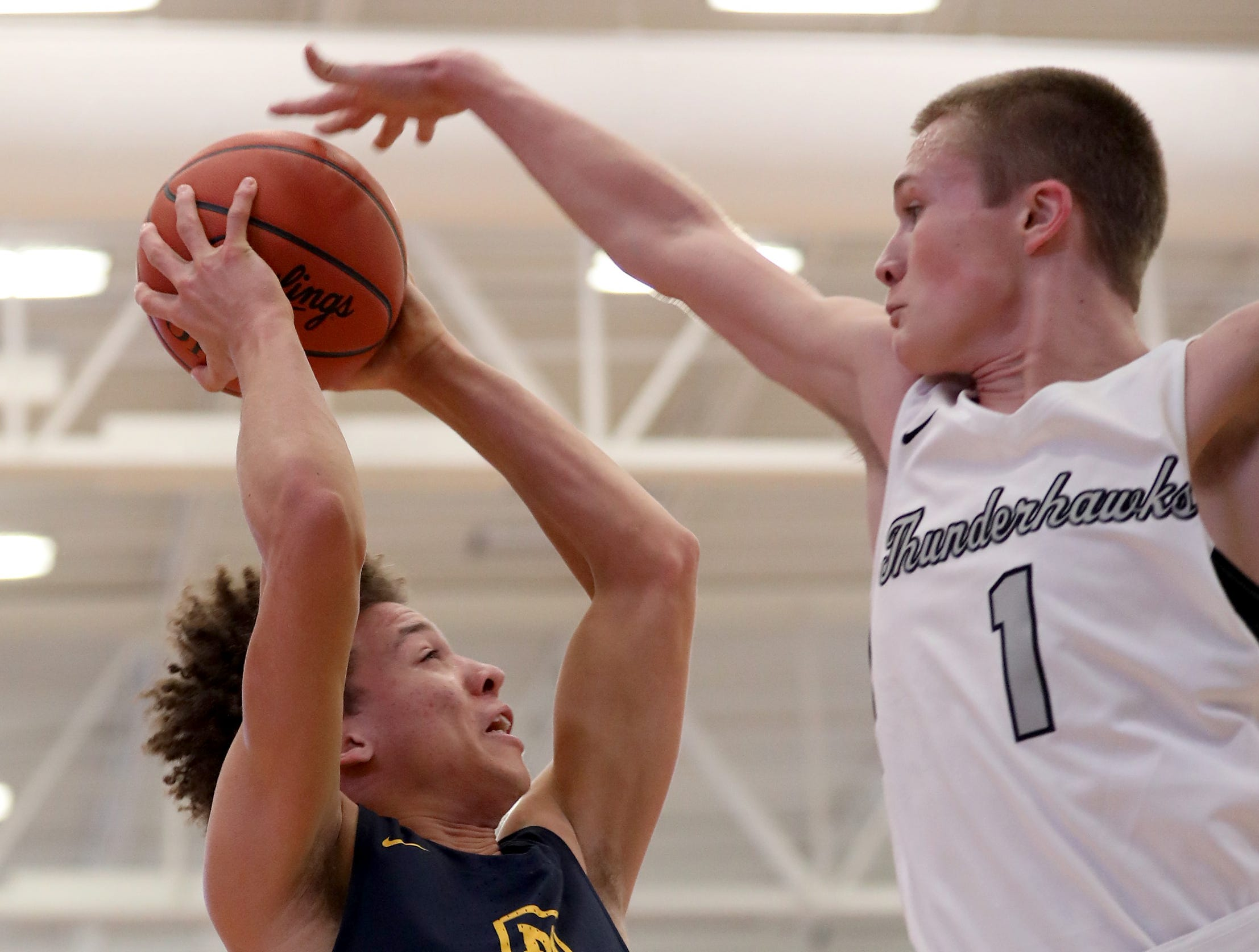 Moeller guard Max Land (22) shoots over Lakota East forward  Nick Holtman  during their game in the Midwest King Classic, Sunday, Jan. 20, 2019.